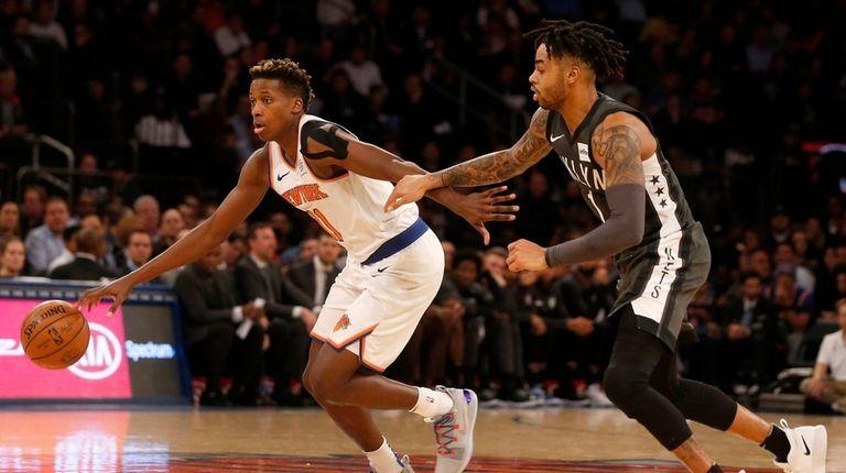 The Knicks' Frank Ntilikina drives past the Nets'