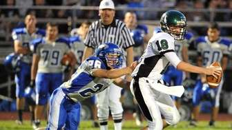 Harborfields Tornadoes quarterback Sean Clark (18) is sacked
