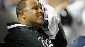 New York Yankees' CC Sabathia (52) wipes his
