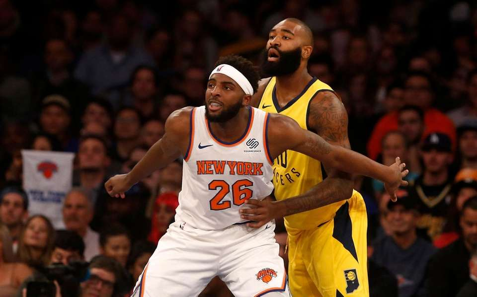 The Knicks' Mitchell Robinson defends against the Pacers'