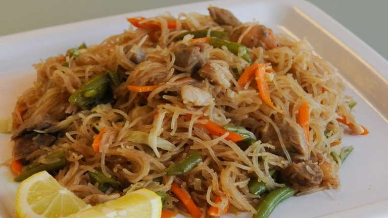 Pancit guisado, rice noodles with pork and vegetables