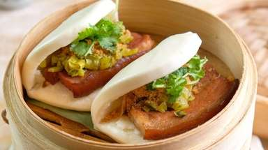 Taiwanese steamed pork buns are finished with cilantro