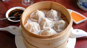 Steamed, Shanghai-style soup dumplings are filled with pork