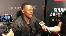 Israel Adesanya speaks to reporters during UFC 230