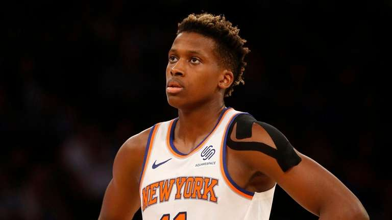 Frank Ntilikina of the Knicks looks on against