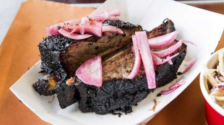 Bone-in beef short ribs with pickled onions and