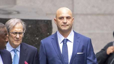 Ex-WFAN personality Craig Carton, right, arrives at federal