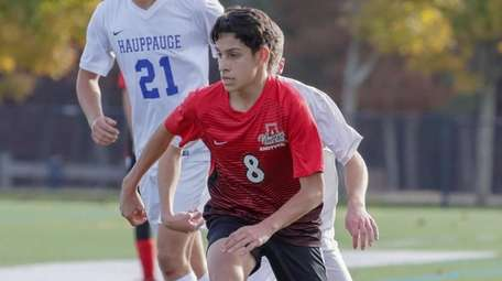 Juan Ponce of Amityville moves the ball up