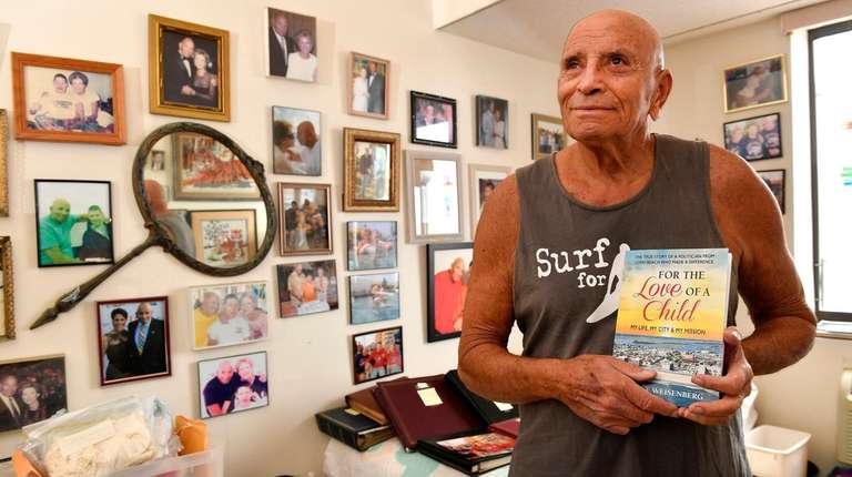 Harvey Weisenberg holds a copy of his autobiogrphy.
