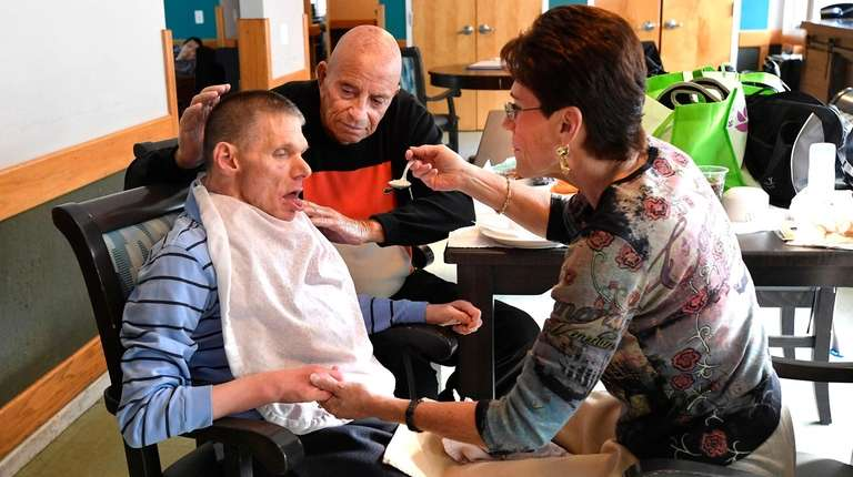 Vicki Laufer feeds lunch to her brother Ricky