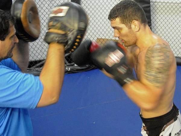 Middleweight Chris Weidman of Baldwin, trains with Ray