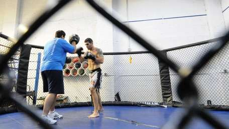 Middleweight Chris Weidman, 26, of Baldwin, trains with
