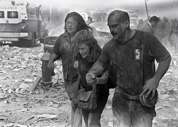 Julie McDermott, center, walks with other victims as