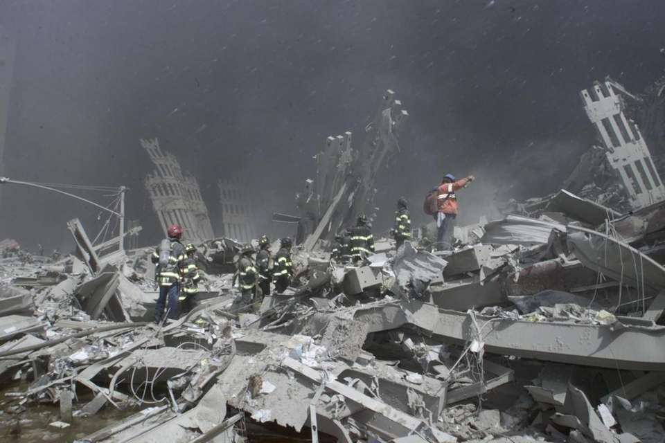Emergency personnel look for victims and fight fires