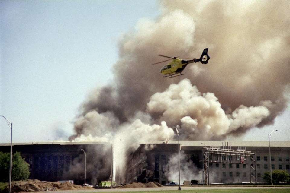 A helicopter flies over the Pentagon in Washington