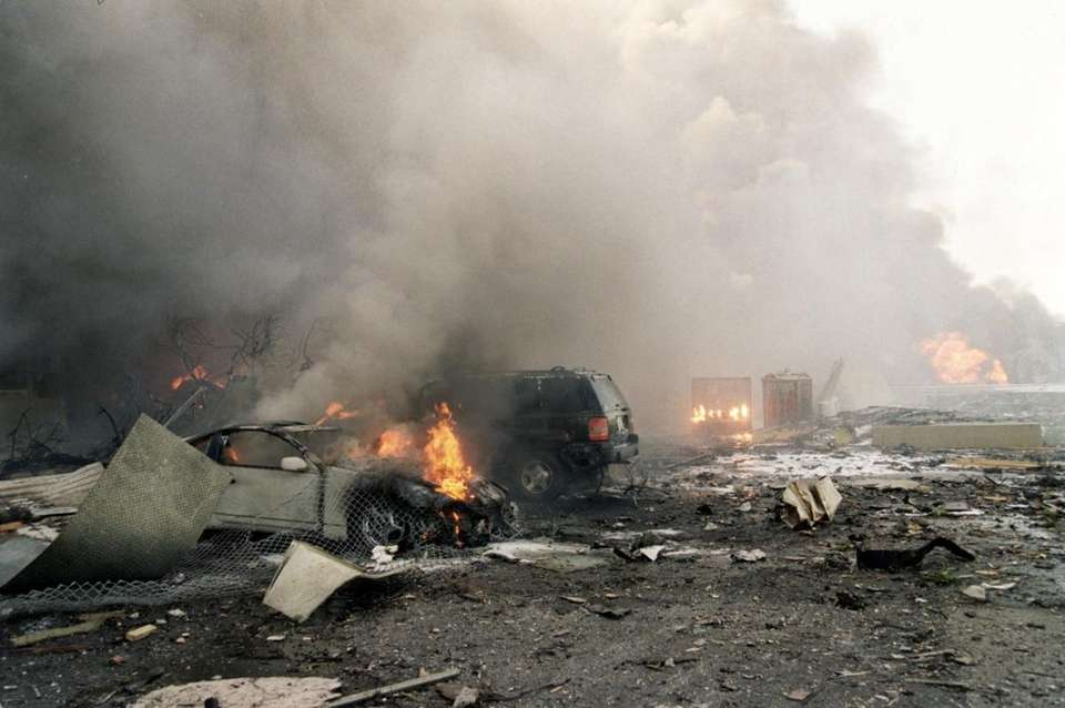 Fires burn amid the rubble outside the Pentagon