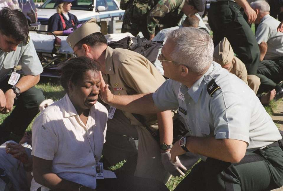 A Pentagon employee is aided outside the building