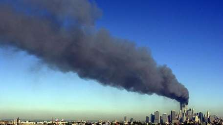 The burning World Trade Center is seen from