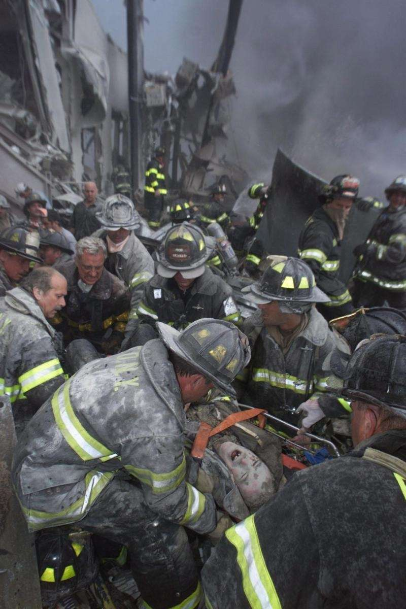 Firefighter Armondo Reno screams in pain during his