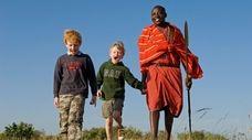 Safari guide Salaash Ole Morompi leads young boys