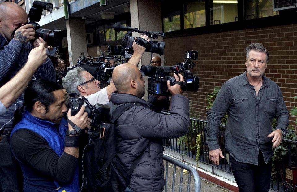 Actor Alec Baldwin leaves the NYPD's 6th Precinct