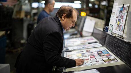 Haig Graphic Communications president James Kalousdian checks pages