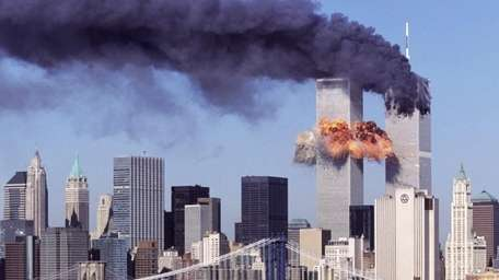 An explosion rips through the south tower of