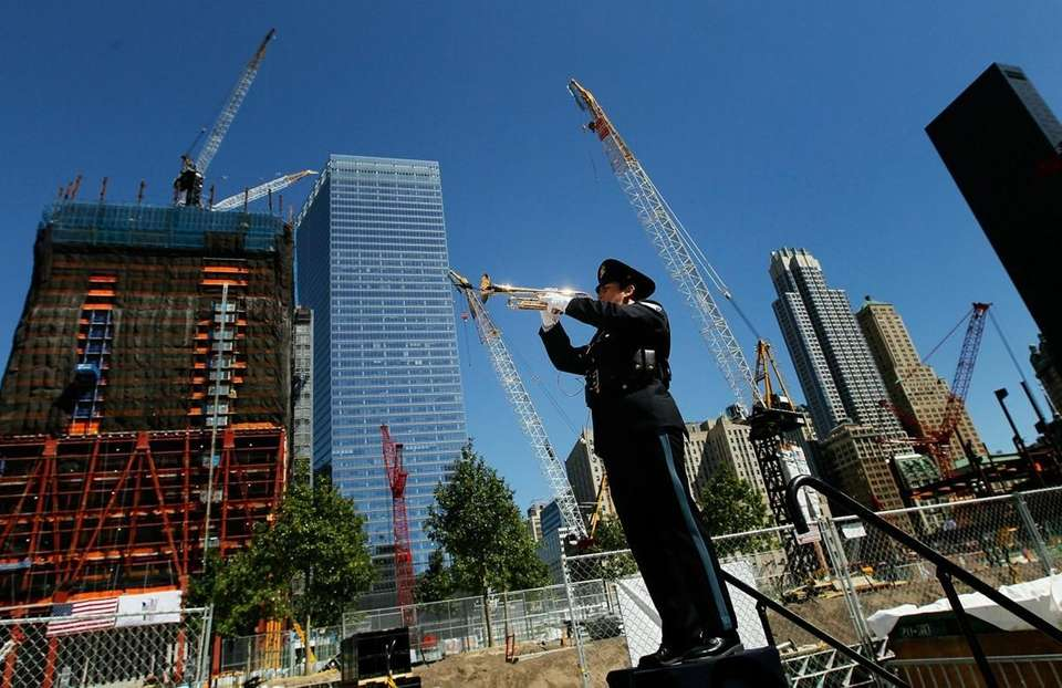 "A trumpeter plays ""Taps"" at Ground Zero to"