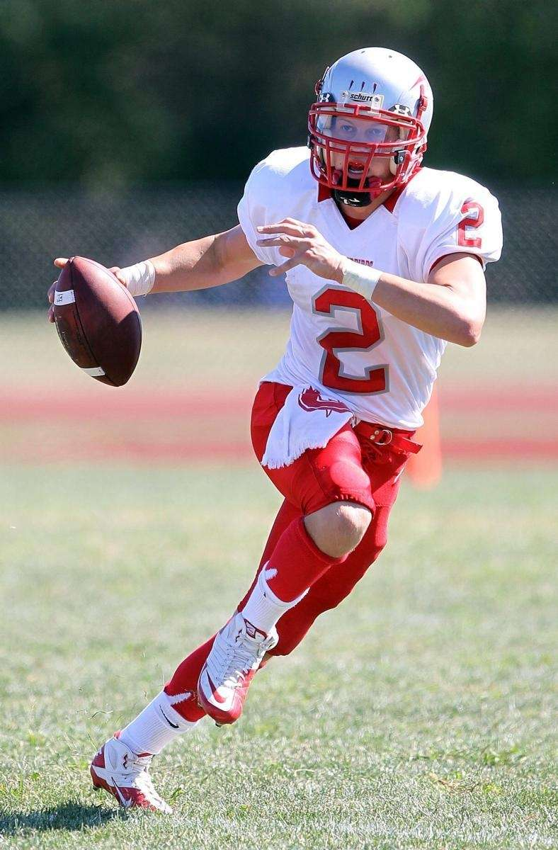 Connetquot's quarterback Kevin Jadick (2) rolls to his