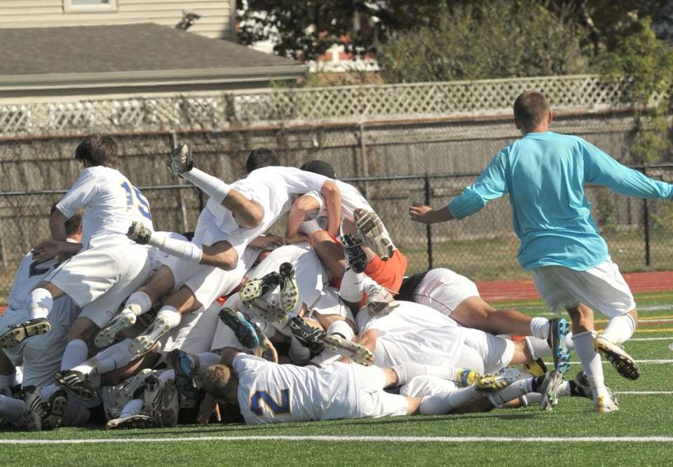 West Islip's boys soccer team celebrates after being