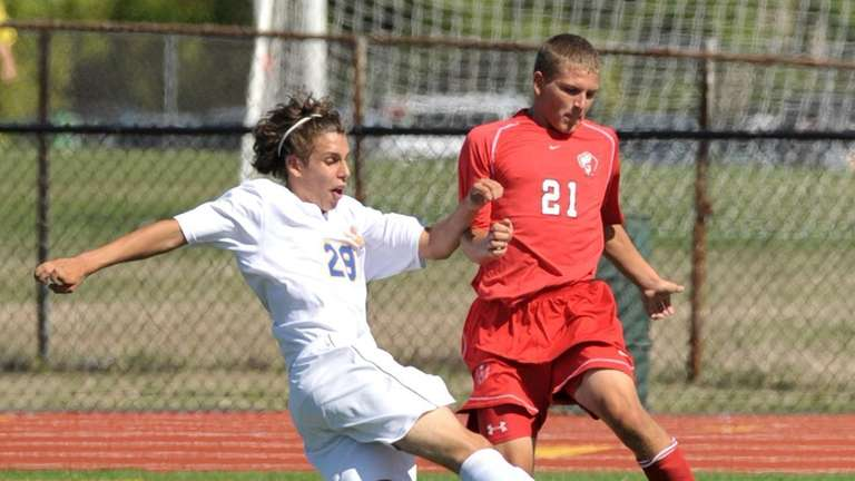 West Islip's Chris Anderson (29, left), fights for