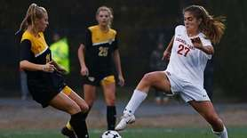 Christina Biscardi #27 of Sacred Heart plays the