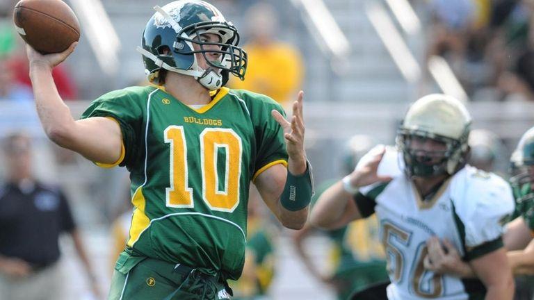 Lindenhurst High School quarterback Stephen Skon drops back