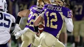 Sayville QB Brock Murtha takes the keeper through
