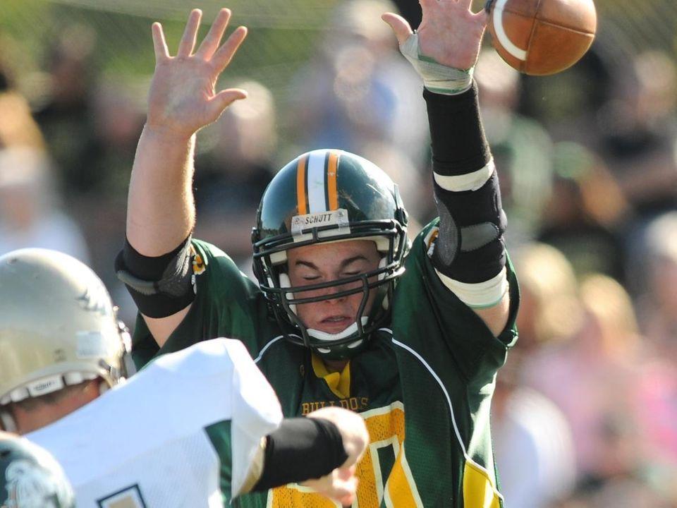 Lindenhurst High School lineman #60 Evan Wildberger, right,