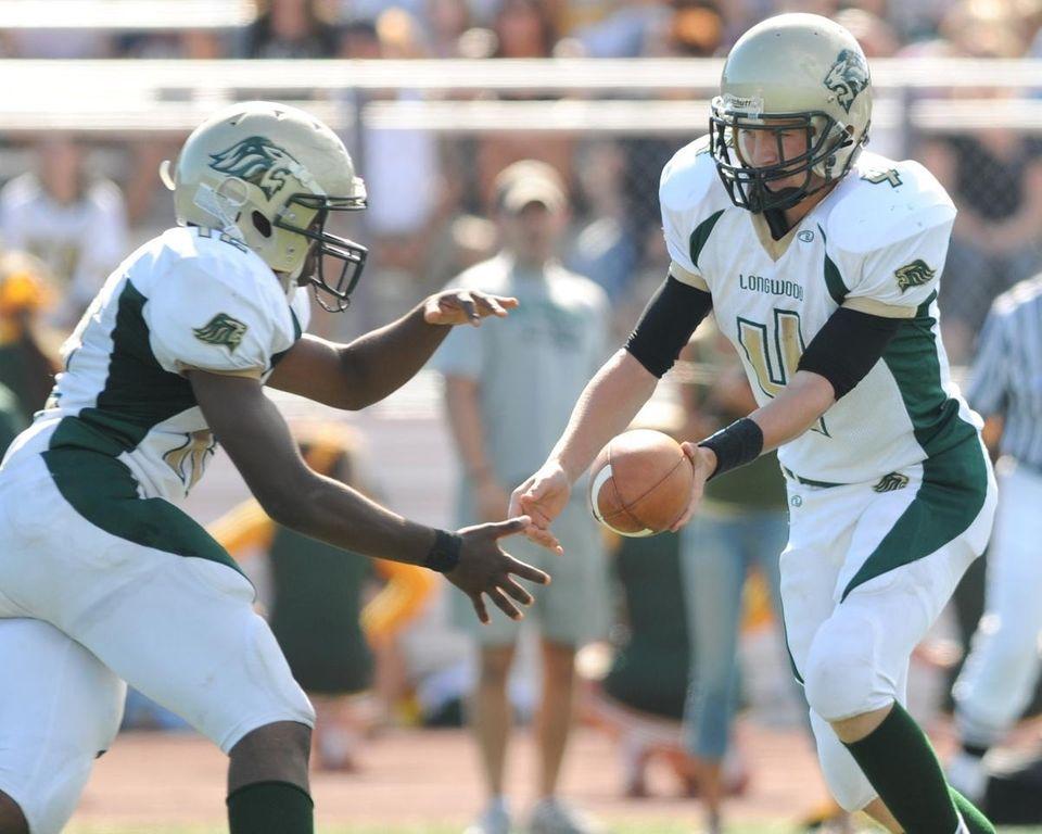 Longwood High School quarterback #4 Danny Farrell, right,
