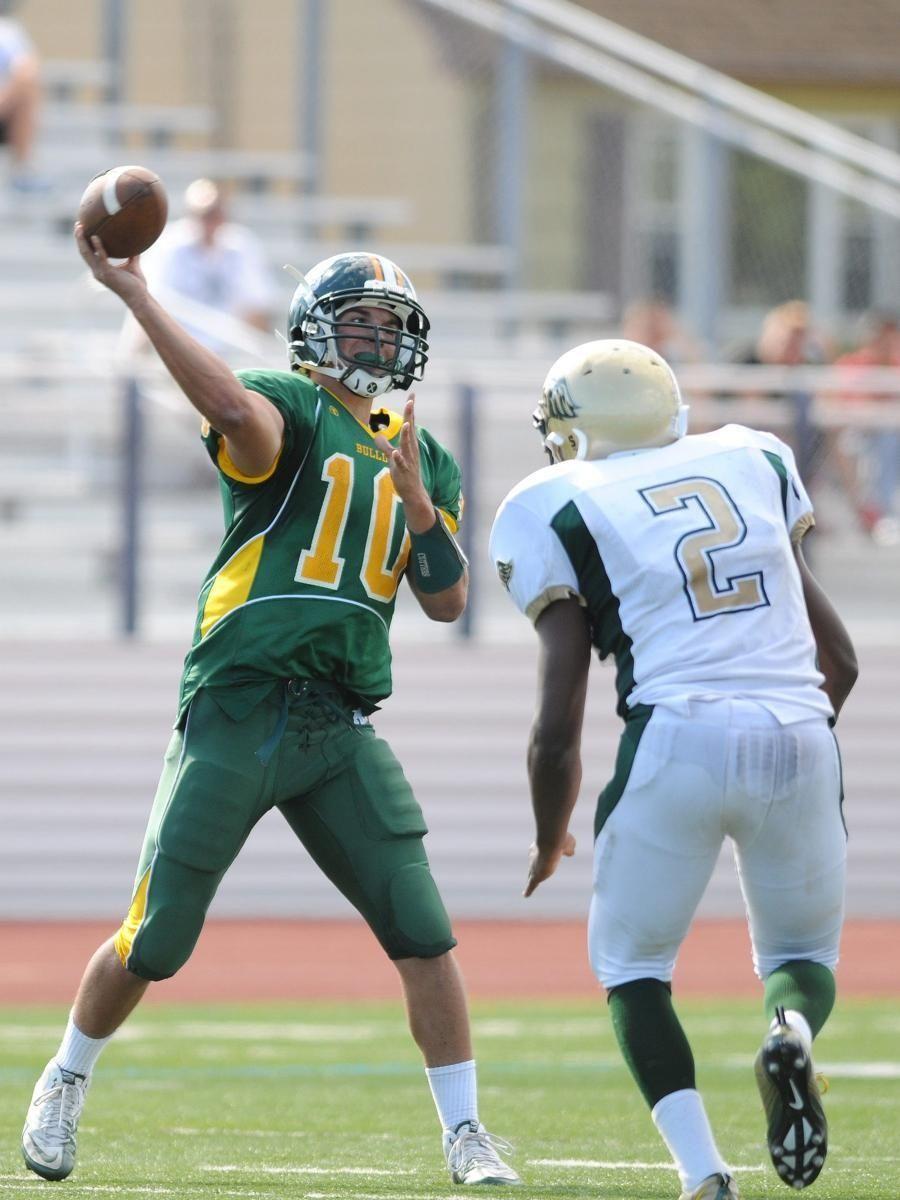 Lindenhurst High School quarterback #10 Stephen Skon, left,