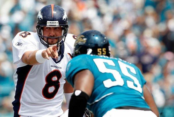 Denver Broncos QB Kyle Orton calls a signal