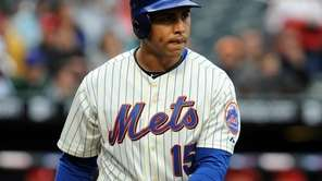 New York Mets' Carlos Beltran (15) strikes out