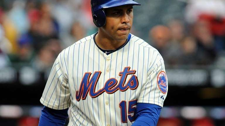 New York Mets' Carlos Beltran (15) strikes out