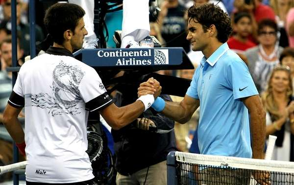 Novak Djokovic of Serbia shakes hands with Roger