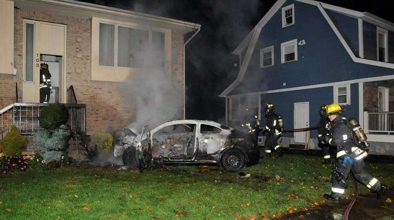 Hicksville firefighters at the Bay Avenue home in
