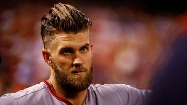 Bryce Harper looks on from the dugout during
