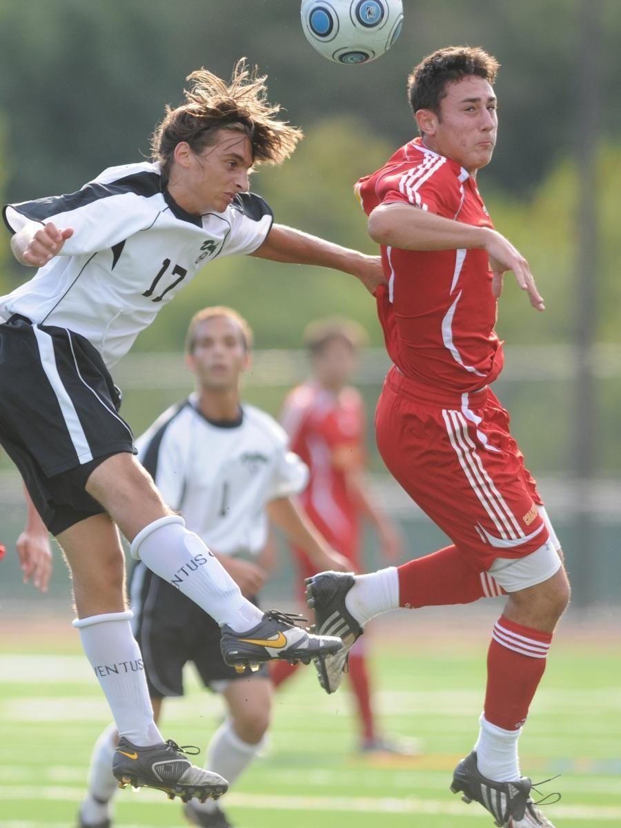 Farmingdale's Chris Giordano, left, heads a ball away
