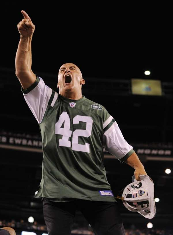 Fireman Ed psyches up the Jets faithful during