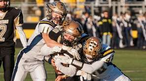 Wantagh's Tom Von Bargen (#20) gets wrapped up