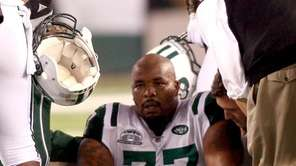 Jets defensive tackle Kris Jenkins sits on the