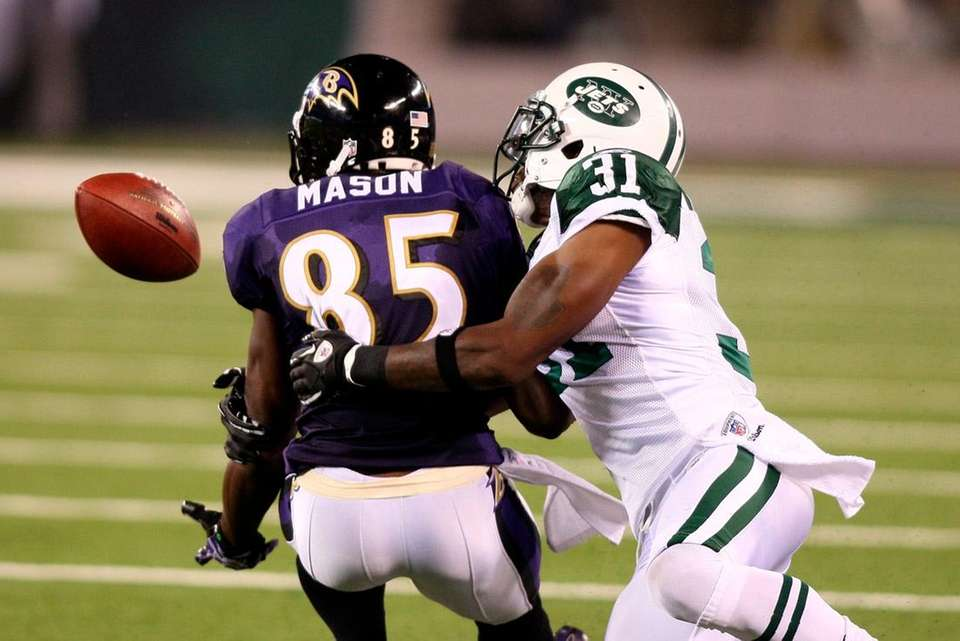 Antonio Cromartie interferes with Baltimore's Derrick Mason. (Sept.