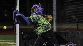 Sachem East goalkeeper Marissa Curves makes the save