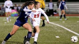 Syosset's Riley Miller and Smithtown West's Emily Leverich
